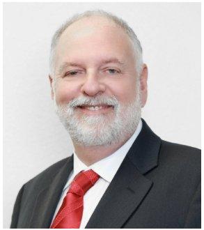 Lowell M. Goode,<br /> <em>Principal</em>